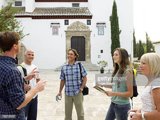 Tourists outside of a church