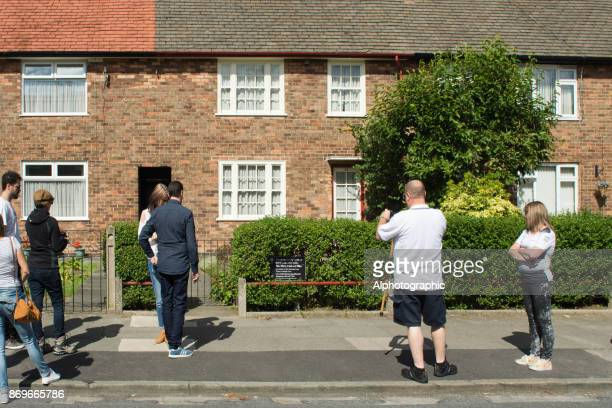 Tourists outside Paul McCartney's former home.