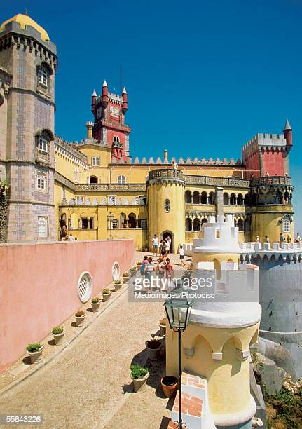 tourists outside the pena castle, sintra, portugal - sintra stock pictures, royalty-free photos & images