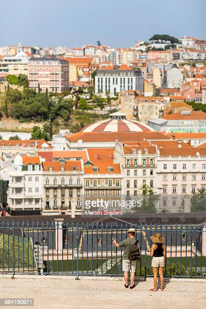tourists overlooking lisbon from park - merten snijders stock-fotos und bilder