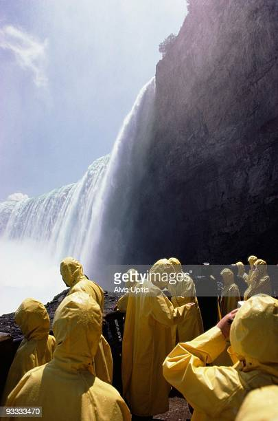 tourists overlooking niagara falls - poncho stock pictures, royalty-free photos & images