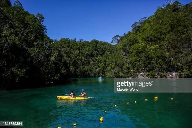 Tourists paddle kayaks inside a lagoon in SIargao Island, Surigao del Norte province south of Manila, Philippines.
