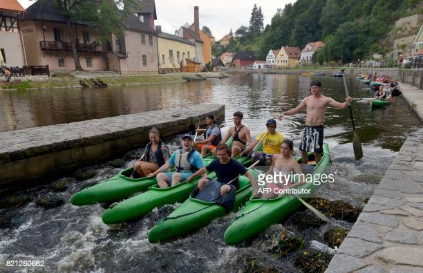 Tourists paddle their canoes on the Vltava River in Cesky Krumlov on July 23 South Bohemia Old Cesky Krumlov and the eský Krumlov Castle is protected...