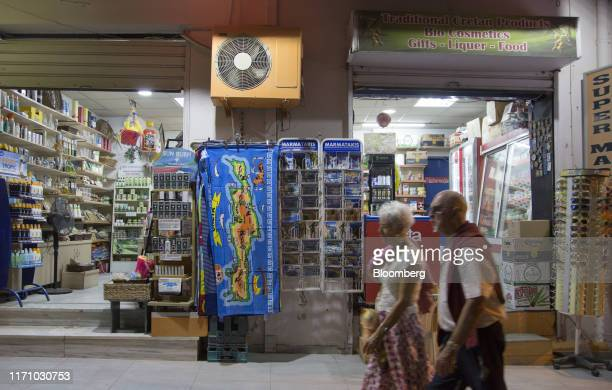 Tourists pass a gift store in Hersonissos, on the island of Crete, Greece, on Tuesday, Sept. 24, 2019. Like Crete, Europes other tourist hot-spots...