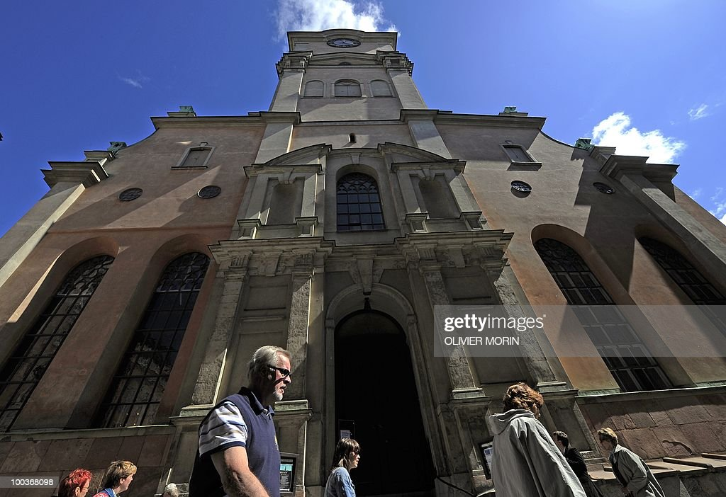 Tourists pass by the Cathedral, near the Royal Castle in Stockholm on May 24, 2010. Many tourists paid a visit to the Swedish capital less than a month before Crown Princess Victoria 's wedding, the 32-year-old eldest daughter of King Carl XVI Gustaf.