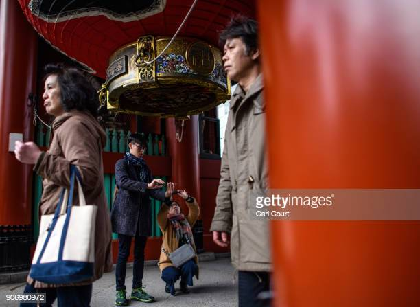 Tourists photograph a huge paper lantern as others pass by at Sensoji buddhist temple on January 19 2018 in Tokyo Japan Sensoji is Tokyo's oldest...