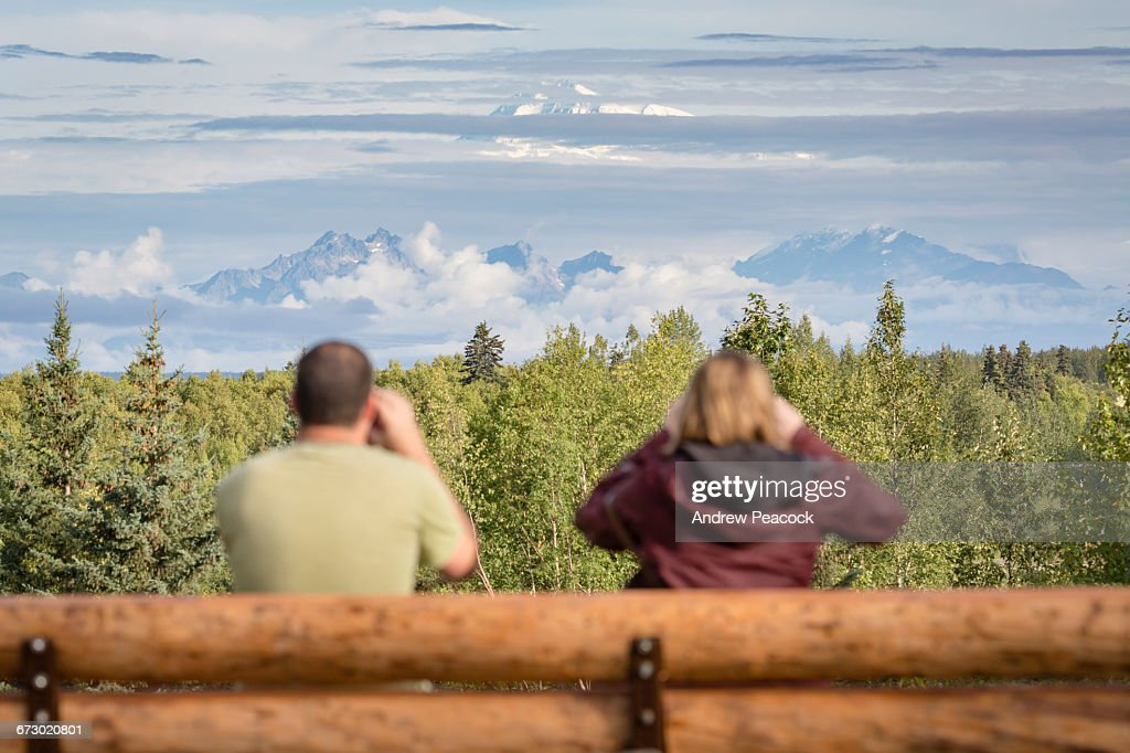 Tourists photograph Denali  from lookout : Stock Photo