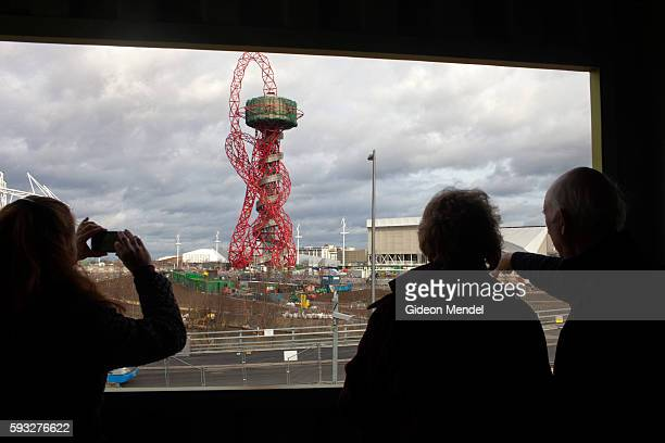 Tourists photograph the ArcelorMittal Orbit tower the controversial tower and sculpture by Amish Kapoor that dominated the site of the 2012 Olympic...