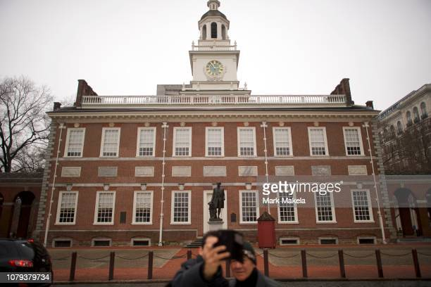 Tourists photograph themselves in front of Independence Hall unable to go inside due to a lapse in federal appropriations on January 8 2019 in...