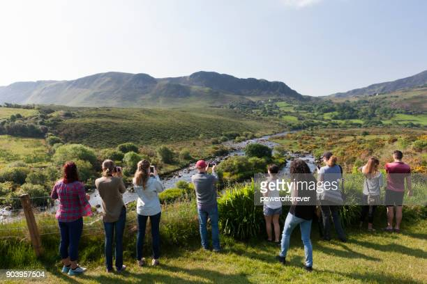 tourists photographing the landscape along the ring of kerry, ireland - ring of kerry stock photos and pictures
