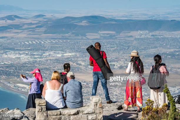 Tourists photographing the view on top of Table Mountain, located in Cape Town, South Africa.