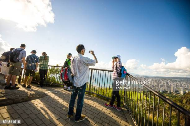 tourists photographing themselves on top of diamond head crater, honolulu, hawaii, usa - diamond head stock pictures, royalty-free photos & images