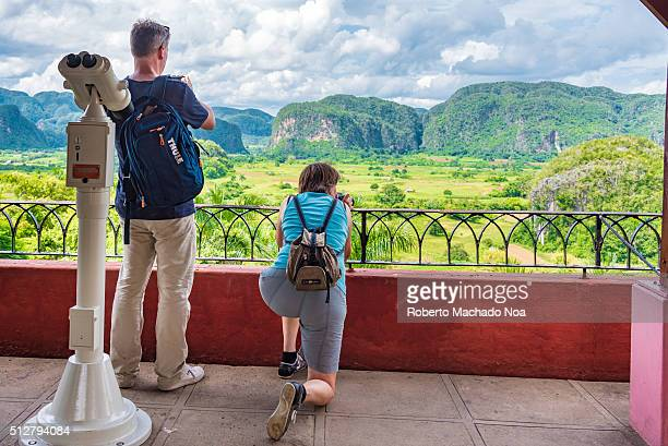 Tourists photographing Valley Vinales one of the most beautiful vistas in the island of Cuba