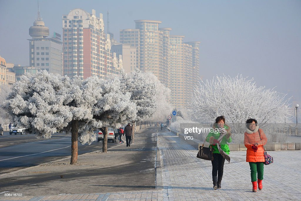 Tourists play a rime resort on January 22, 2016 in Jilin, Jilin Province of China. The National Meteorological Center (NMC) on Friday issued a yellow alert for blizzards that are expected to sweep China's northern, central and eastern regions.