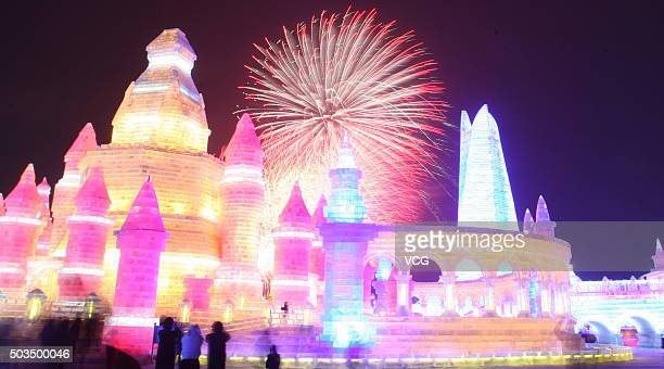 Tourists play at the opening ceremony of China 32nd Harbin Ice Snow Sculpture Festival on January 5 2016 in Harbin Heilongjiang Province of China The...