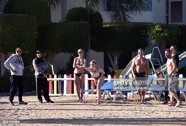 Tourists play bowels the beach at the Bella Vista Hotel in Egypt's Red Sea resort of Hurghada on January 9 the day after the hotel came under attack...