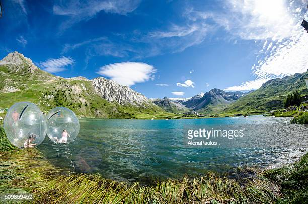 Tourists Playing in Plastic Bubble Lac Tignes France