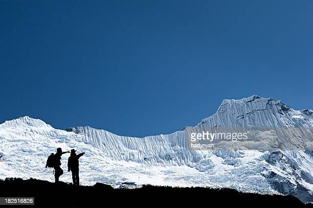 Tourists pointing at peak