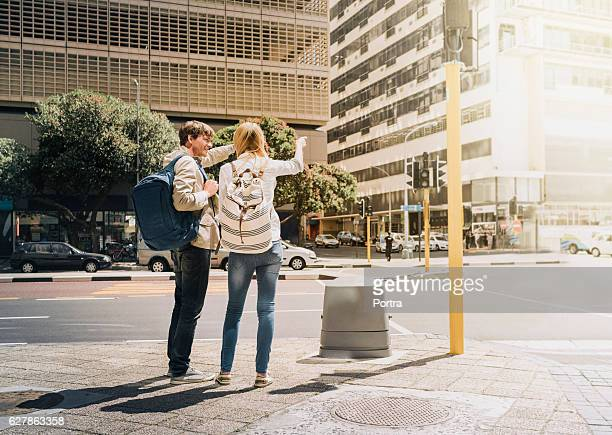 Tourists pointing while standing in city