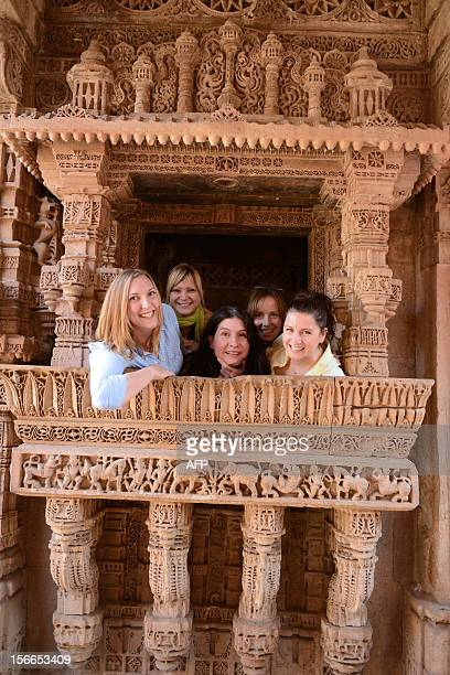 Tourists pose at the 'AdalajNiVav' stepwell in Adalaj in Gandhinagar district some 35kms from Ahmedabad on November 18 on the eve of World Heritage...