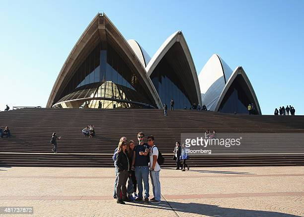 Tourists pose for a selfie photograph in front of the Sydney Opera House in Sydney Australia on Tuesday July 21 2015 Tired hotels outdated...