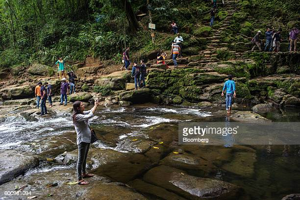 Tourists pose for photographs at a 'living root bridge' not pictured in Mawlynnong Meghalaya India on Monday Aug 15 2016 Two years of deficient...