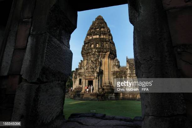 Tourists pose for photographs at Phimai Sanctuary on November 3 2012 in Phimai District Nakhon Ratchasima ThailandThe Khmer ruins are loacted on the...