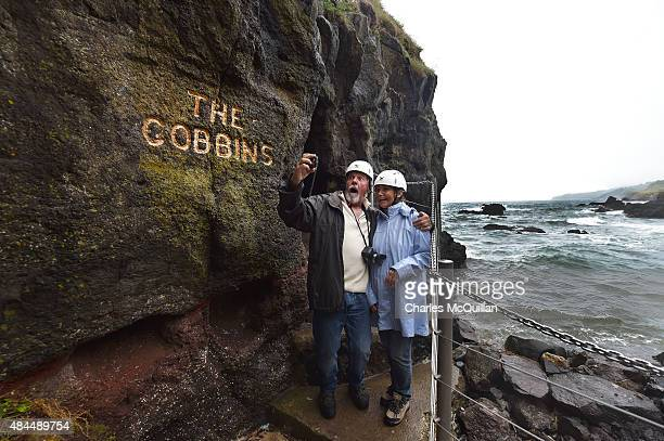Tourists pose for photographs at The Gobbins coastal path on August 19 2015 in Antrim Northern Ireland The Islandmagee cliff path walk known as The...