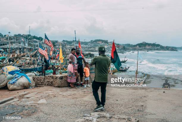 "Tourists pose for pictures at the Cape Coast Castle on August 18, 2019. - African-American visitors are flocking to Ghana as it marks the ""Year of..."