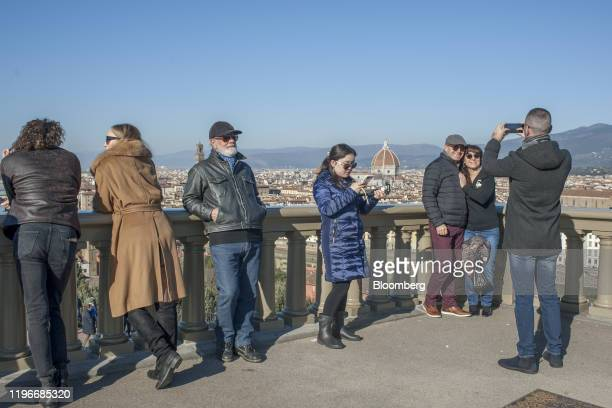 Tourists pose for pictures in Florence Italy on Sunday Jan 12 2020 Rocco Commisso who grew up in the Bronx and played soccer for Columbia University...