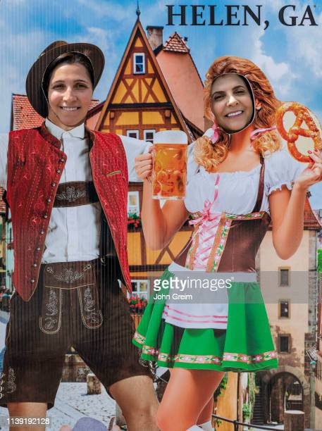Tourists pose in German Octoberfest motif cutout