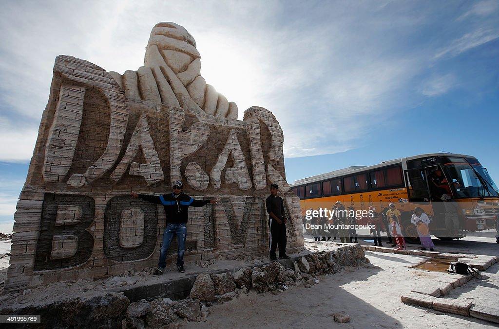 Tourists pose near the large sculpture representing the Dakar Rally made using salt blocks in the Salar de Uyuni or Uyuni Salt Flat during Day 7 of the 2014 Dakar Rally on January 11, 2014 in Uyuni, Bolivia.