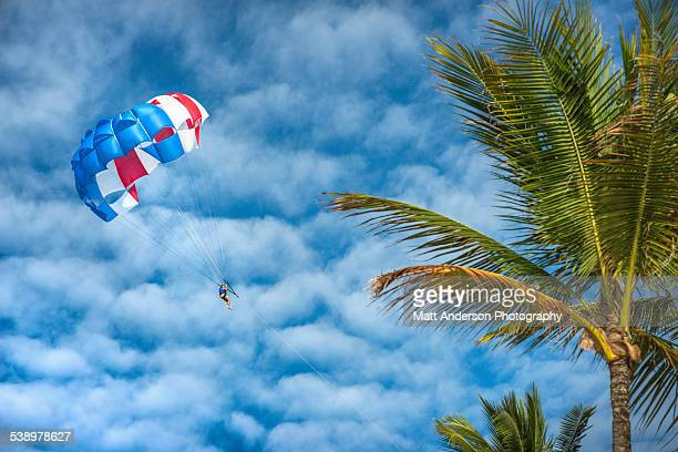 Tourists practice parasailing at Bavaro Beach