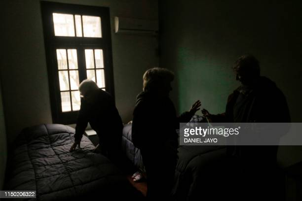 Tourists prepare to go out during a power cut in Montevideo on June 16 2019 A massive outage blacked out Argentina and Uruguay Sunday leaving both...