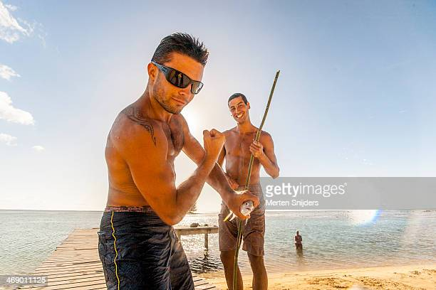 Tourists proud of bamboo rod catch