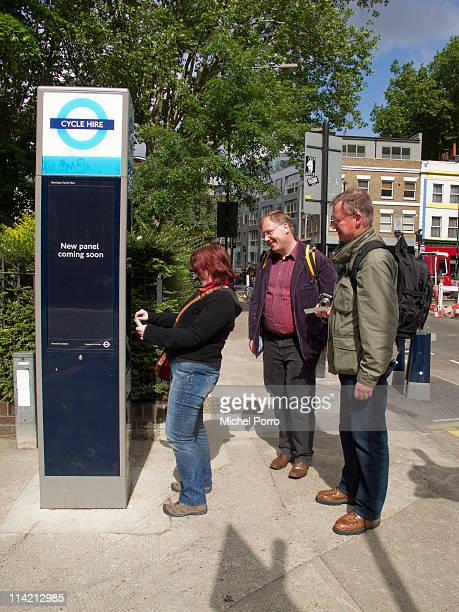 Tourists purchase a ticket at a Barclays Cycle Hire station on May 2011 in London England The no booking selfservice is available 24 hours a day all...