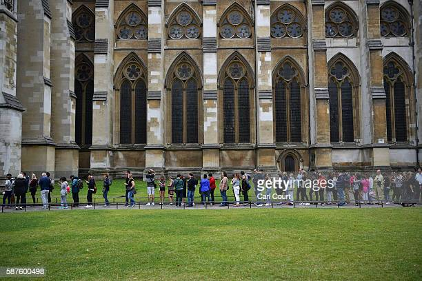 Tourists queue for Westminster Abbey on August 1 2016 in London England The UK's tourism industry is set to benefit from a weak pound following...