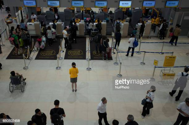 Tourists queue to check in at Nok Air counters for their flights at Don Muang International Airport in Bangkok Thailand on 9 March 2017