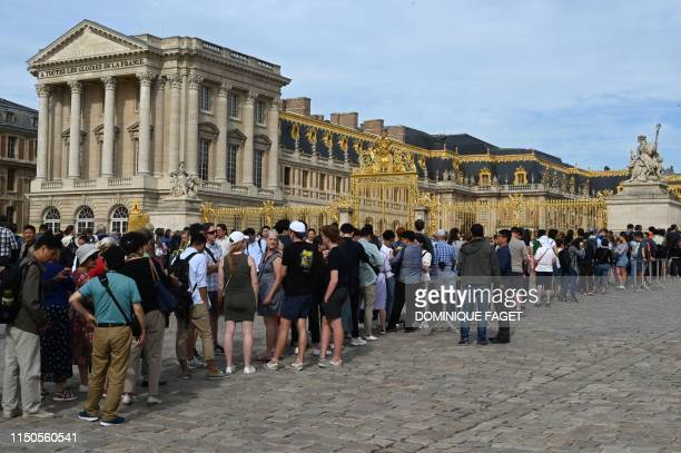 Tourists queue to enter and visit the Palace of Versailles the principal royal residence of France from 1682 under Louis XIV until the start of the...