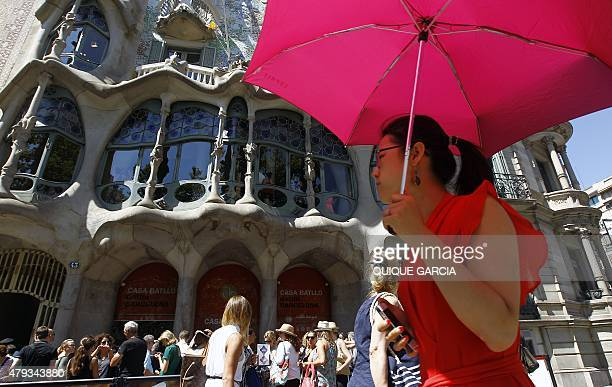 Tourists queue to visit Spanish architect Gaudi's Casa Batllo in Barcelona on June 28 2015 Tourists generated 14% of municipal GDP but these 27...