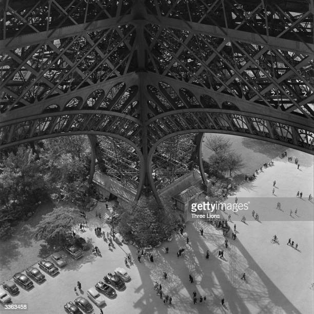 Tourists queue up to climb the Eiffel Tower in Paris a 300 metre high wroughtiron structure built in 1889 for Paris' World Fair