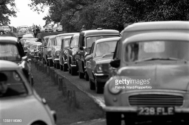 Tourists queueing up in their motorcars to enter the grounds of Woburn Abbey in Bedfordshire, circa July 1969. From a series of images to illustrate...