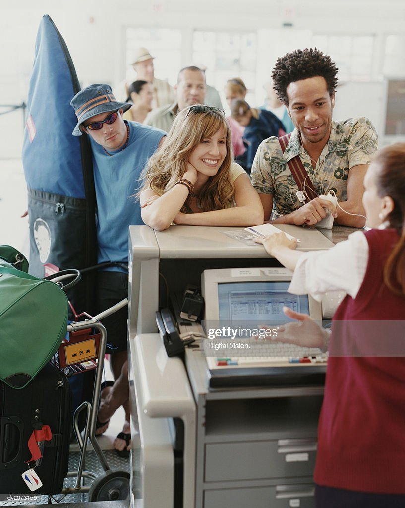 Tourists Queuing at an Airport Check-in : Stock Photo