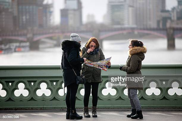 Tourists read a map on Westminster Bridge in London UK on Tuesday Dec 29 2015 The odds are stacking up against the pound for 2016 as Britain's...