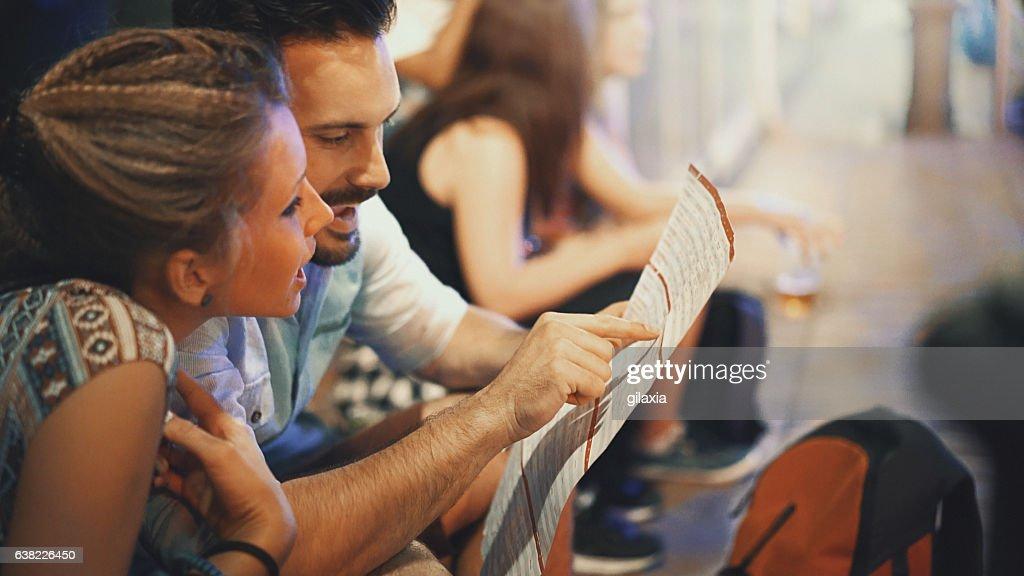 Tourists reading city map. : Stock Photo