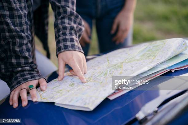 Tourists reading road map