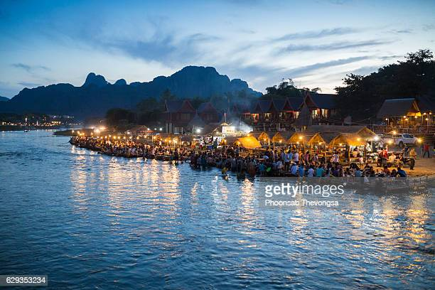 Tourists relax along Xong river in Vangvieng, Vientiane, Laos.
