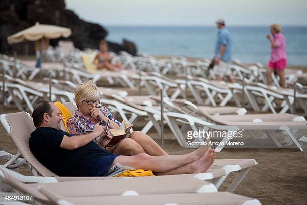 Tourists relax on Puerto del Carmen beach on April 12 2014 in Lanzarote Spain Lanzarote where British Prime Minister David Cameron and his wife...