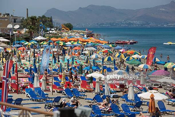 Tourists relax on the beach front on June 03 2015 in Kos Greece The Island has recently seen a drop in tourist numbers which has been attributed to...