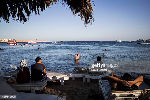 Tourists relax on the beach of Nama Bay on November 05 2015 in Sharm ElSheikh Egypt If the tourism industry in Egypt collapses workers who rely on...